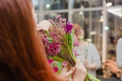 Flowers hands red girl, bouquet different buds royalty free stock image