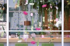 Flowers hanging decoration. The artificial colorful flowers hang royalty free stock photo