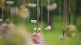 Flowers hanging on strings in forest in wedding day outdoors stock video footage