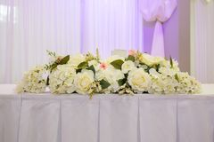 Flowers on the head table at an indian wedding. Flowers arranged on a head table at wedding Stock Photography