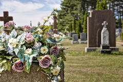 Flowers on a headstones in a cemetery Royalty Free Stock Photos