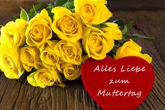 Flowers and a Heart. Yellow roses with a red heart made of felt with the words Alles Liebe zum Muttertag Royalty Free Stock Images
