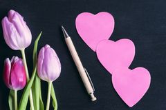 Flowers and heart shaped paper notes Stock Image