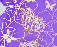 Flowers, hearts, butterfly over purple background. Hologram Stock Photos