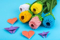 Flowers, hearts origami on blue background. Studio Photo Royalty Free Stock Image