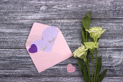 Flowers and hearts on wooden background. Greeting card. Wedding invitation concept. Valentine day. Stock Images