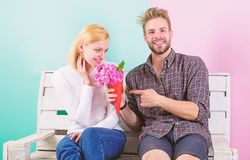 Flowers for her. Bouquet favorite flowers. Man gives bouquet flowers to girlfriend. He guessed her favorite flower. Pleasant surprise for lady. Man women sit royalty free stock photos