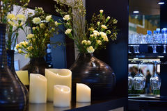 Flowers and home decore interior. Flowers, candles and home decor interior stock photos