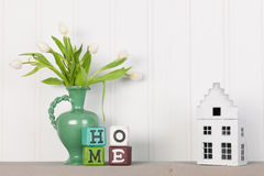 Flowers at home. Vase white tulips and decoration at home royalty free stock photography
