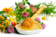 Flowers and honey Stock Photos