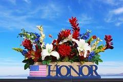 Flowers and honor at Mt. Soledad National Veterans Memorial. Beautiful multi-colored flowers under blue sky to honor Veterans at Mt. Soledad National Veterans royalty free stock image
