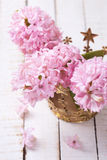 Flowers hyacinths in decorative crown on white  painted wooden p Stock Photography