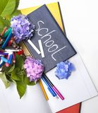 Flowers hydrangeas and school subjects. Stock Images
