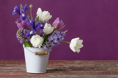 Free Flowers In Bucket On Pink Background Royalty Free Stock Photo - 134855175