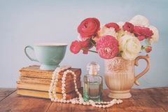 Free Flowers In The Vase Next To Old Books, Pearls Necklace And Perfume Bottle Royalty Free Stock Image - 90787976