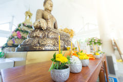 Flowers, incense and candles set for Buddhist worship Buddha. Stock Images