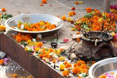 Flowers and incense sticks. At a in temple in India Royalty Free Stock Photography