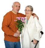 Flowers for injured wife Stock Image