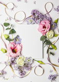 Flowers and invitation card Stock Photos