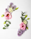 Flowers and invitation card. Festive invitation card with beautiful floral border on the white textured background Stock Image