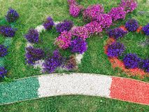 Flowers with Italian flag. Colorful flower arrangement with Italian flag royalty free stock photography