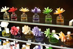 Flowers in jars with fragrant oils. On dark Royalty Free Stock Images
