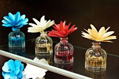 Flowers in jars with fragrant oils. On dark Royalty Free Stock Image