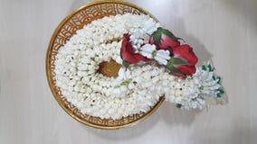 Flowers - jasmine, hundreds on the yarn called `jasmine bunch`. For worship, as a souvenir, beautiful, lovely, handmade, professional art Royalty Free Stock Photos