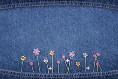 Flowers on jeans royalty free stock photography