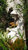 Flowers for Jesus. NJesus and the flowers in the church garden on a beautiful day Stock Photo