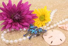 Flowers and Jewelry stock image