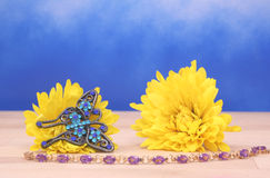 Flowers and Jewelry. Flowers With Butterfly Broach and Bracelet, Focus on Broach and Flowers Royalty Free Stock Image