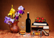 Flowers, jewelry and books Stock Photo