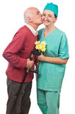 Flowers and kiss for doctor Stock Photo