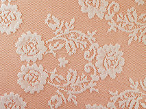 white rose flowers lace pattern on pink fabric background Royalty Free Stock Photography