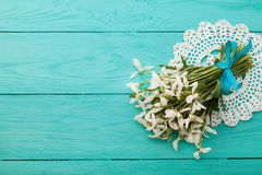 Flowers and lace ribbon on blue wooden background Royalty Free Stock Photo