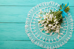 Flowers and lace ribbon on blue wooden background. Snowdrops and lace ribbon on blue wooden background Stock Photography