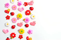 Flowers, ladybug, hearts, wallpaper. Design, colorful mood, flowers, ladybug, hearts, wallpaper, Toy figure on a white background Stock Image
