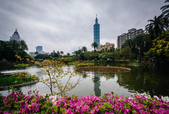 Flowers, lake, and Taipei 101 at Zhongshan Park, in the Xinyi Di Stock Image