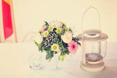 Flowers and lamp on table Royalty Free Stock Image