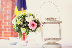 Flowers and lamp on table Stock Images