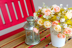 Flowers and lamps on a wooden table Royalty Free Stock Photography