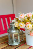 Flowers and lamps on a wooden table Stock Image