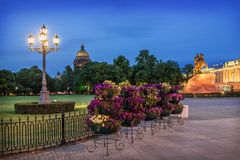 Flowers and a lantern on the Senate Square of St. Petersburg Stock Photo