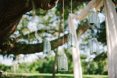 Flowers, lanterns, cloth hanging from a large oak tree in Florid Stock Photo