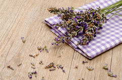 Flowers of lavender on a cloth and wood Royalty Free Stock Photography