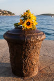 Flowers laying on a cement stand. Royalty Free Stock Photography
