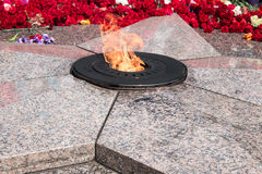 Flowers laying to the eternal flame. Memorial in honor of the fallen soldiers in the city of Omsk Russia Stock Image