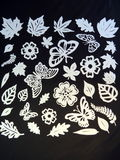 Flowers, leaves and butterflies. Paper cutting Stock Photo