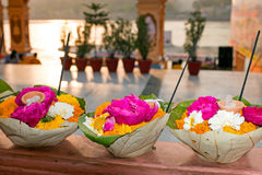 Flowers in leaves ready for a puja at the temple at the river Ganges. In India Asia Stock Photo